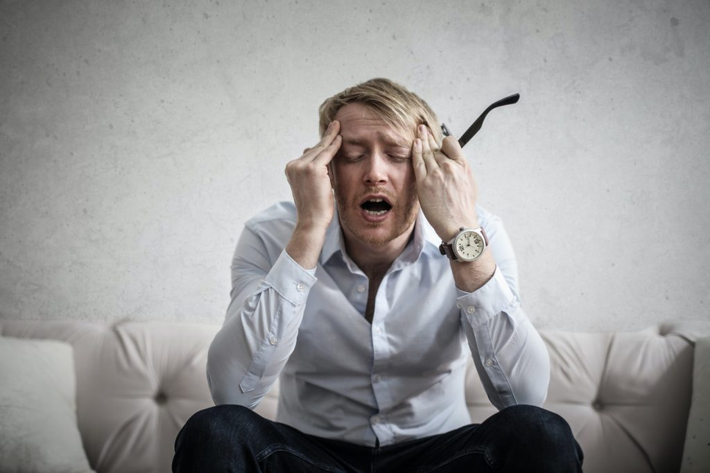 man stressed in pain tinnitus guide