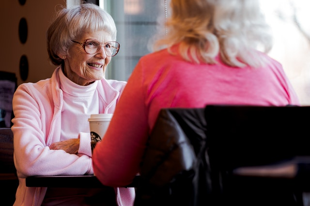 Old Woman Sitting And Talking OTC Hearing Aid Effective over the counter hearing aids benefits and risks
