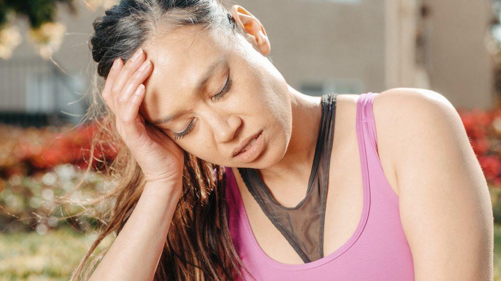 woman in pink tinnitus permanent tinnitus curable