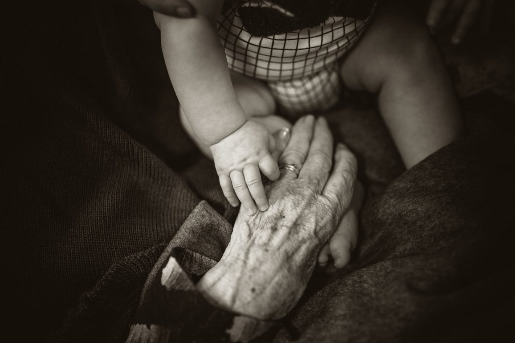 baby hand old hand aging us hearing loss statistics