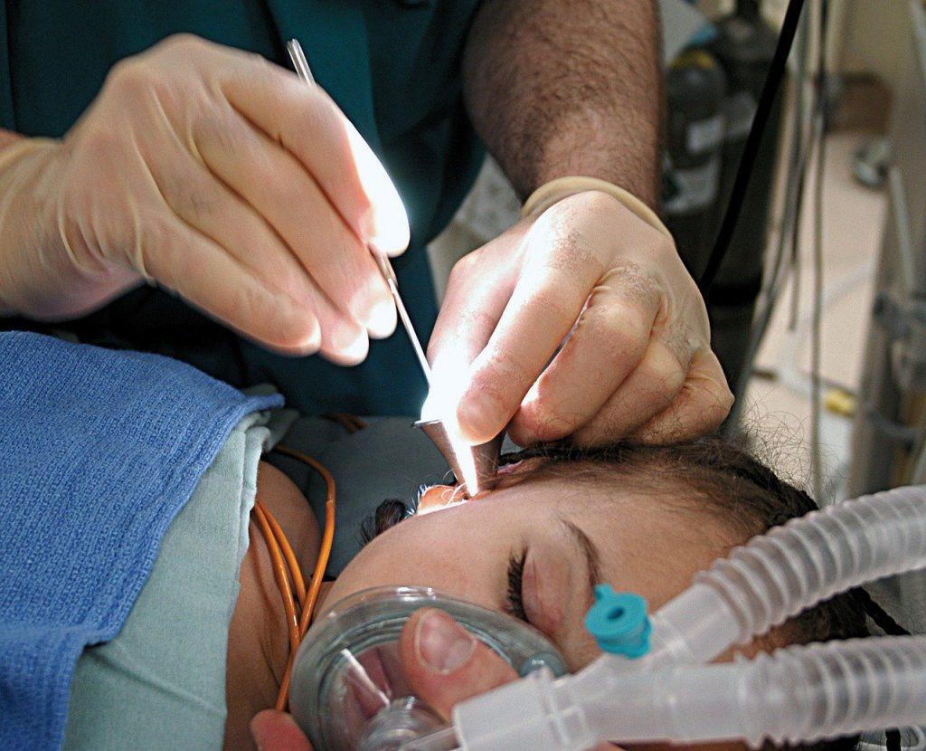 woman ear inspection ent vs audiologist