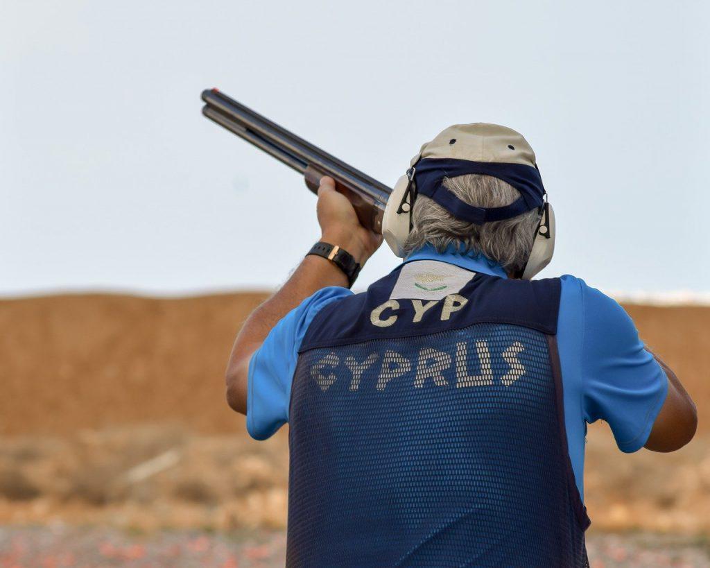 Man Holding Gun Hunter Hearing Protection
