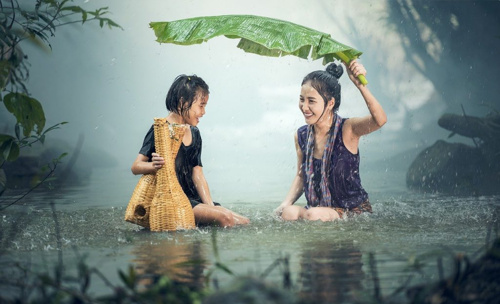 woman and kid in rain Hearing Aid Maintenance