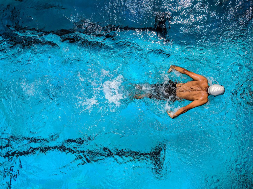 man swimming How to clean hearing aids